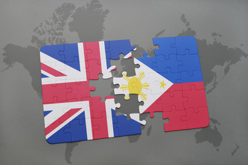 puzzle with the national flag of great britain and philippines on a world map background.