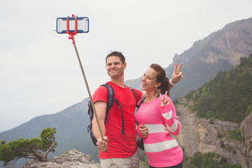 Young traveler couple taking a selfie picture.