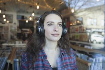Young woman wearing headphones.