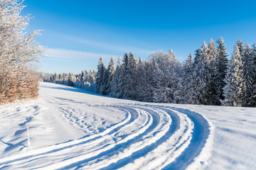 Winter road on sunny day in Beskid Sadecki Mountains, Poland