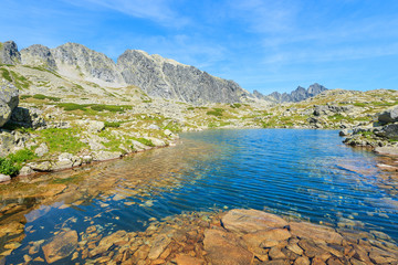 View of beautiful alpine lake in summer landscape of Starolesna valley, High Tatra Mountains, Slovakia