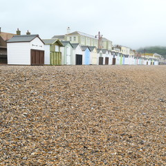 Gravel with beach huts on Jurassic Coast  in Seaton, Devon