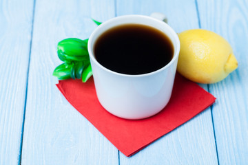 Cup of tea on blue wooden background.