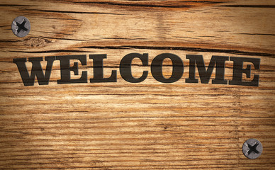 WELCOME - title on the wooden background with the nails