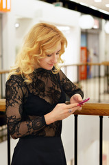 Portrait of a girl writing sms on phone