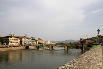 Urban landscape with bridge over river Arno in Florence, Italy