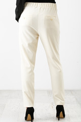 Young beautiful woman in a white pants and black shoes
