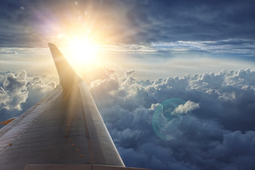 Fotobehang - Wing of the plane on blue sky