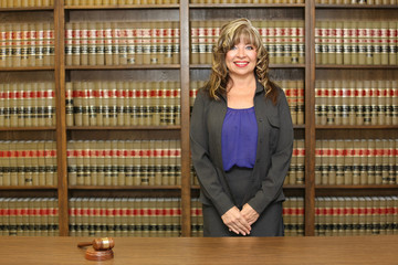 Portrait middle aged attractive career woman, woman lawyer in law office. woman in power