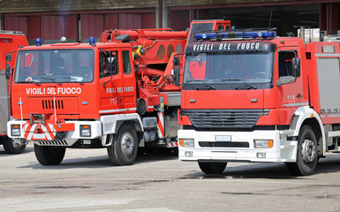 many red truck fire engines firefighters