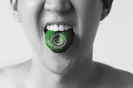 Arab League flag painted in tongue of a man - indicating Arabic language