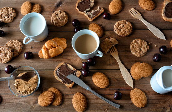 Few chocolate cookies and biscuits with milk