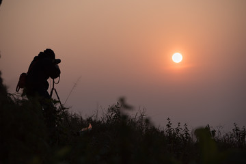 Photographer take a photo of the sunrise