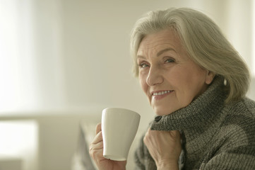 Senior woman with cup