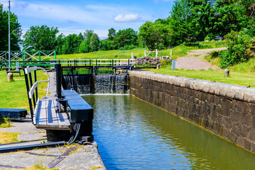 Narrow canal with closed canal lock at the end. Gota canal in Sweden.