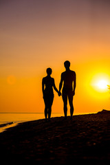 Couple of lover holding hand with sunrise