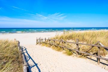 Entrance to beautiful sandy beach in Lubiatowo coastal village, Baltic Sea, Poland
