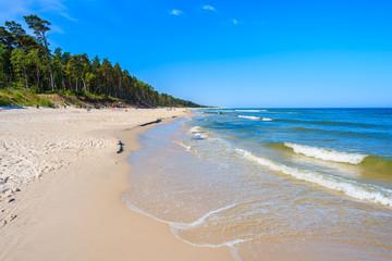 A view of white sand beach and blue Baltic Sea, Bialogora coastal village, Poland