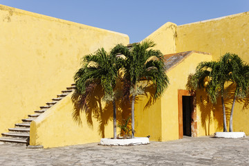 The bright yellow walls of Fort San Miguel, Mexico