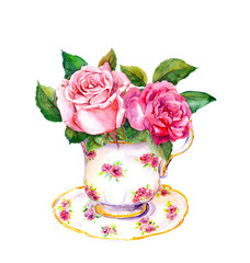 Vintage tea cup with rose flowers. Watercolor