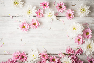 Pink and white flowers on the white wooden table