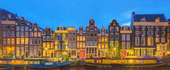 Canvas Prints Amsterdam Amstel river, canals and night view of beautiful Amsterdam city. Netherlands