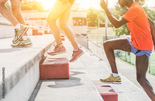 Athletic people running in stadium on terrace stairs for Terrace jogging track