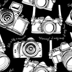 Seamless pattern with the images of cameras. Vector illustration.
