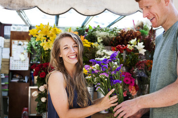 Man gifting flowers to his girlfriend