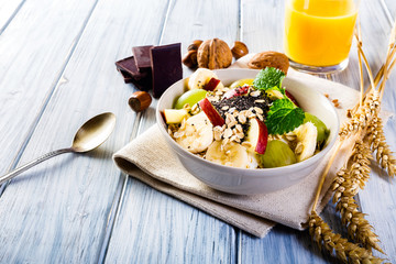 Oatmeal with yoghurt and fresh fruit.