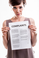 Thoughtful woman holding a list of complaints
