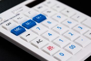 Calculator on black background