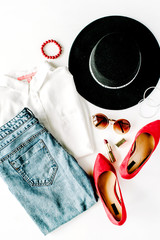 flat lay feminine clothes and accessories collage with cardigan, trousers, sunglasses, watch, bracelet, lipstick, mint high heel shoes, earrings and purse on white background.