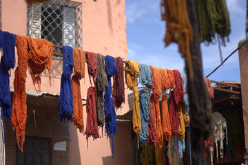 The hand-colored fabrics, laid out to dry