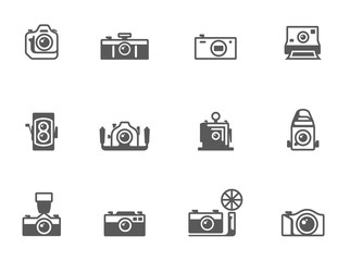 Camera icons in black & white.