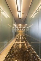 Modern office corridor with glass doors