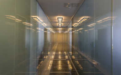 Modern office corridor with glass doors