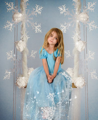 Fairy Child on Winter Frozen Ice Swing