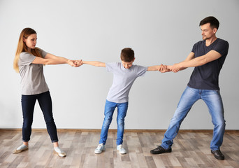 Family problems concept. Little boy between parents