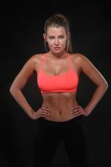 Beautiful Woman Wearing Sexy Workout Clothing on Black