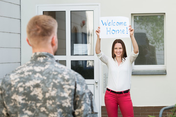 Wife Welcoming Her Husband Home