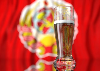 a glass of beer in front a Soviet Union flag. 3D illustration rendering.