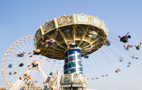 Ferris-wheel and chain swing ride at an amusement park