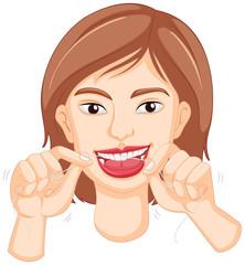 Woman flossing the teeth