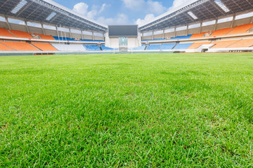 Green lawn in a open stadium
