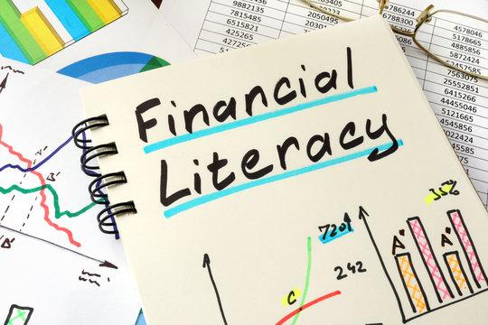 Financial Literacy written on a notepad sheet.