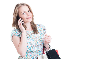 Beautiful fashion girl talking on mobile phone