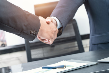 Good deal. Close-up of two business people shaking hands while s