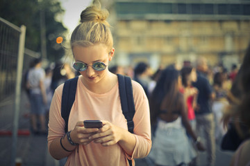 Blonde girl using her smartphone