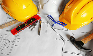 Construction plans and builder equipment on table